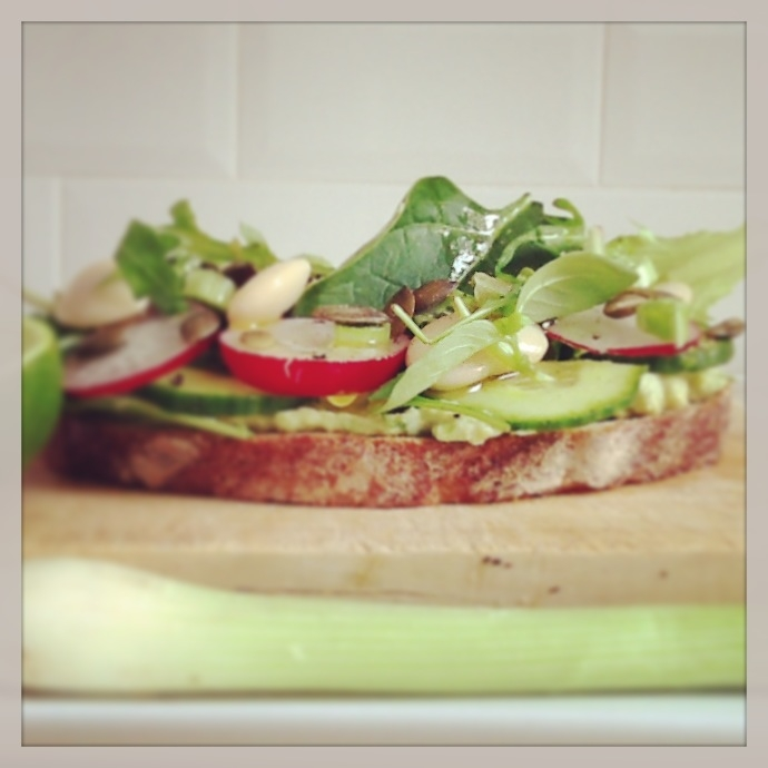 rye bread, humus, avocado, spring onions ,mix baby lives, cucumber, pumpkin seeds, butter bean ,radish , lime