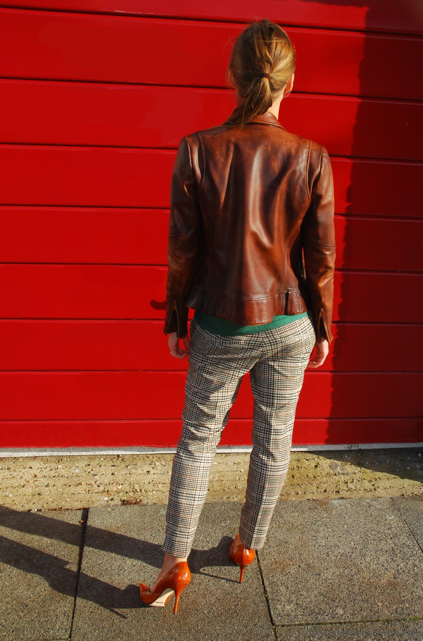 gucci biker jacket , mickey mouse,mickey mouse t-shirt, vintage bag ,snake skin clutch ,h&m trousers, gucci yellow sunglasses, tom ford for gucci sunglasses ,
